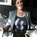 Busty French lady wearing see through shirt in public
