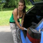 Sweet babe reveals her big boob as she vacuums the car
