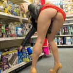 Super sexy blonde displays her round booty and pussy at the store