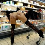 Crazy bitch in stockings spreads her ass cheeks and pussy at the store