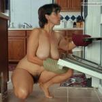 Huge titted mature housewife with super hairy twat cooking butt naked