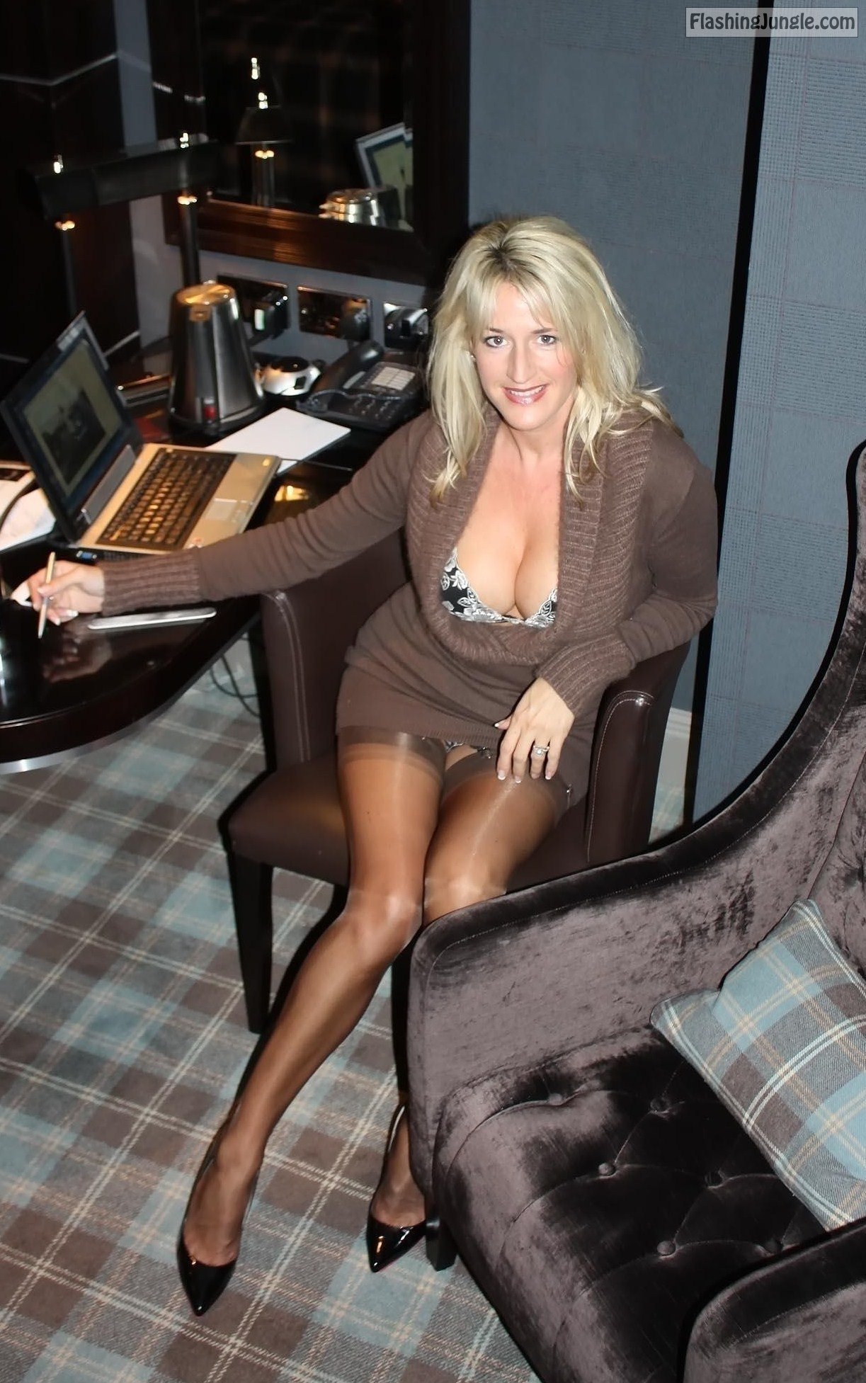 Busty secretary in stockings flashes her panties at the office upskirt milf pics