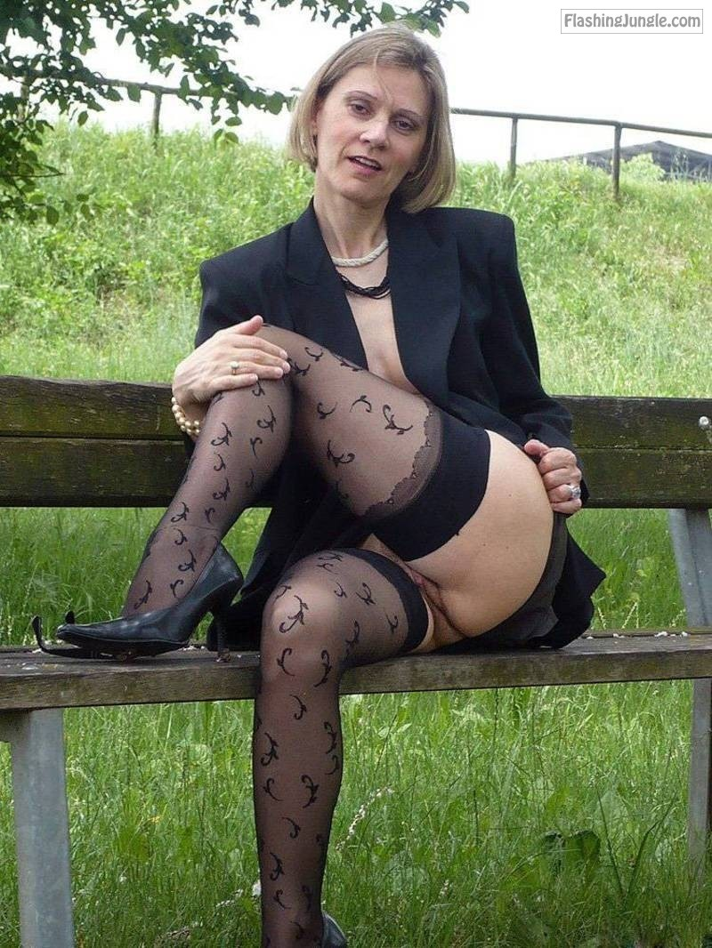 Middle aged amateur woman in black stockings flashes her mature cunt outdoors pussy flash public flashing no panties mature bitch