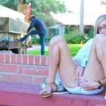 Nerdy blonde removes her tiny shorts and rubs her muff in public