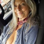 Cute mature lady wears no bra in public