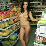 Cool brunette fully nude on high heels in store