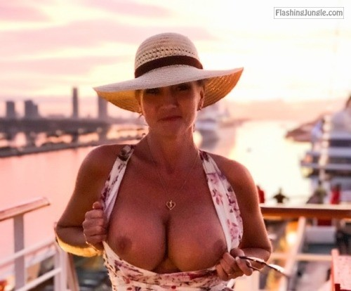 Public Flashing Pics MILF Flashing Pics Boobs Flash Pics - Busty MILF with a hat flashing round tits