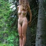 Golden hair teen with pink nipples and big breasts in forest