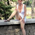 Pale wife without underwear in white dress flashing