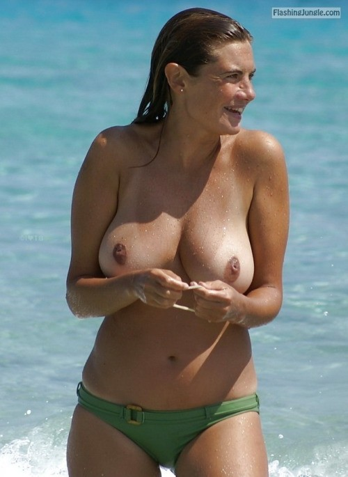 Big natural boobs and tan lines topless on beach