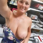 Selfie of Young MILF big natural pierced boob out at store