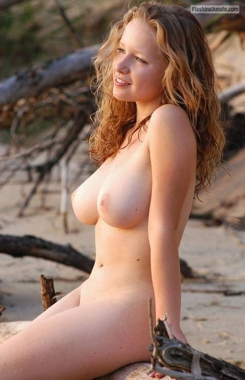 Redhead babe with big natural tits on the beach public flashing