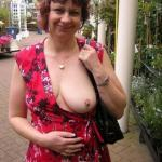 Big mature juicy boob out – lady in red showing off tiny pierced nipple