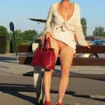 Blond MILF no panties under white clothes – Reed heels and red handbag…
