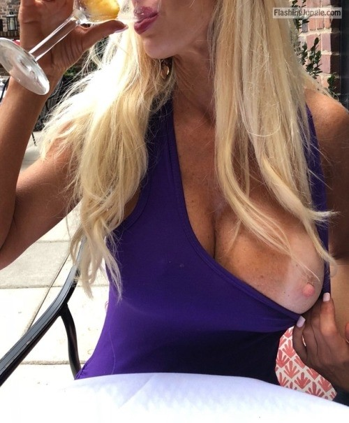 Rich blonde in blue dress one <strong>big boob</strong> out at restaurant