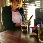 Voyeur caught nipple under white blouse of sexy cougar in pub while texting