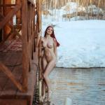 Fiery redhead naked outside on winter day