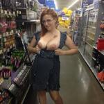Nerdy redhead boobs out in the supermarket