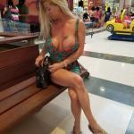 Luxury blonde wife intentional boob slip in shopping mall