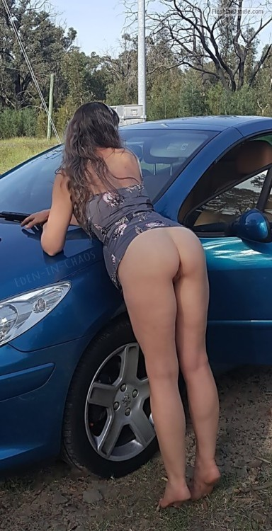 Bent over the car on tip toes very hot public nudity photo of my bottomless wife no panties