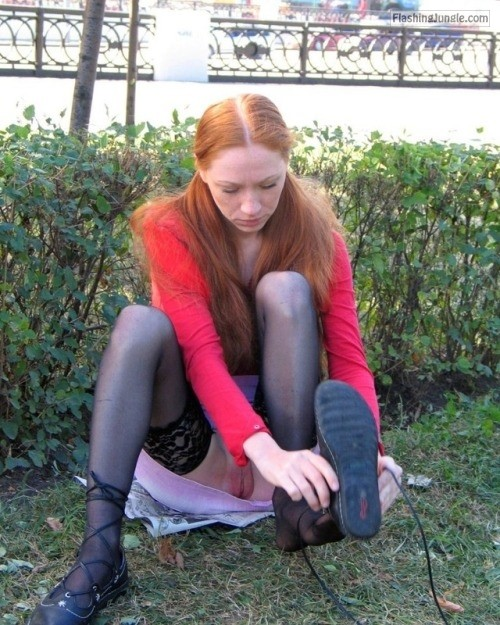 Bottomless ginger exposed pussy while changing shoes in park public flashing