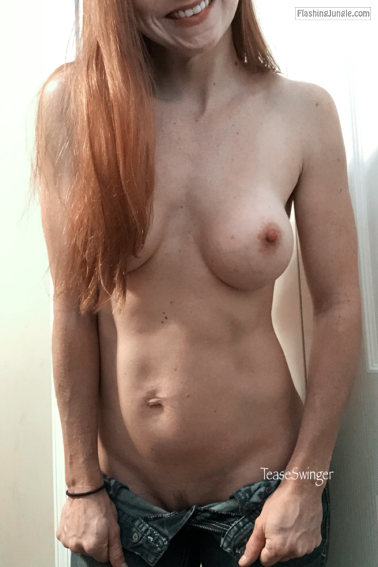 Skinny redhead MILF getting nude with a smile howife