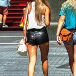Underbutt showing in her tight leather shorts
