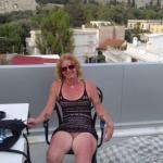 Mature woman knickerless on balcony