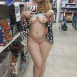 Curvy blond wife flashing pussy and tits at toy store