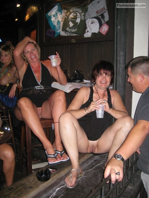 Two pantieless mature flashing slags at a bar drinking voyeur upskirt pussy flash public flashing no panties milf pics mature howife bitch