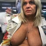 Mature blonde flashing round natural boobs in a bus