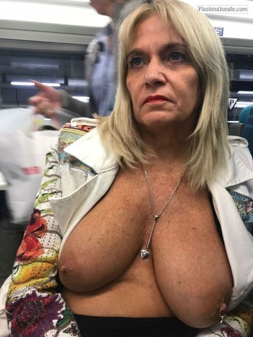 Mature blonde flashing round natural boobs in a bus public flashing milf pics mature boobs flash