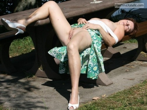 Tanning her bare mature cunt and tits on park bench