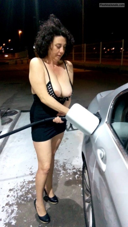 Mature dark haired woman fueling car boobs out public flashing milf pics mature boobs flash