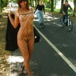 Teen in fishnet costume no underwear in park