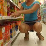 Pantieless wife with juicy pussy among store shelves