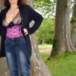 Mature woman in see trough blouse boobs flash in park