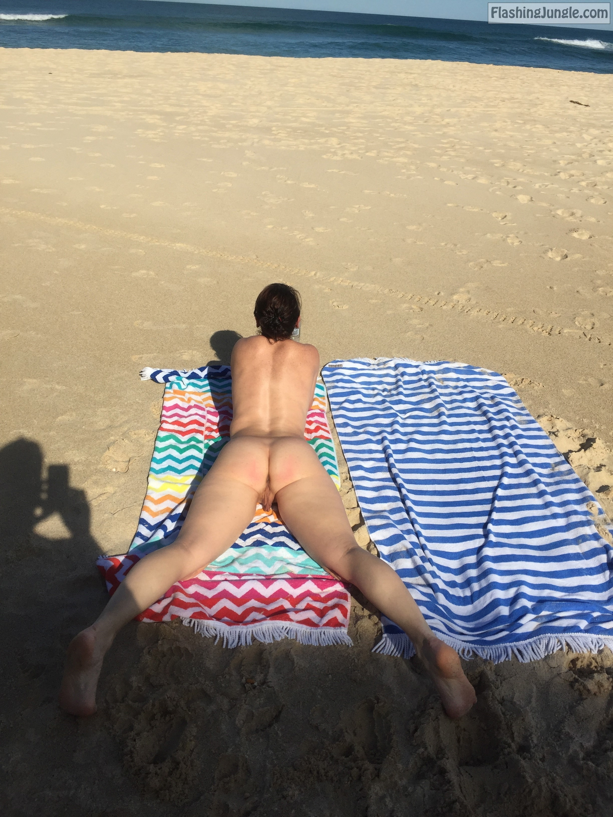 Sharing nude wife on public beach