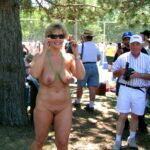 Sexy mature woman naked in a crowd