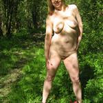 Mature slut stripping in nature