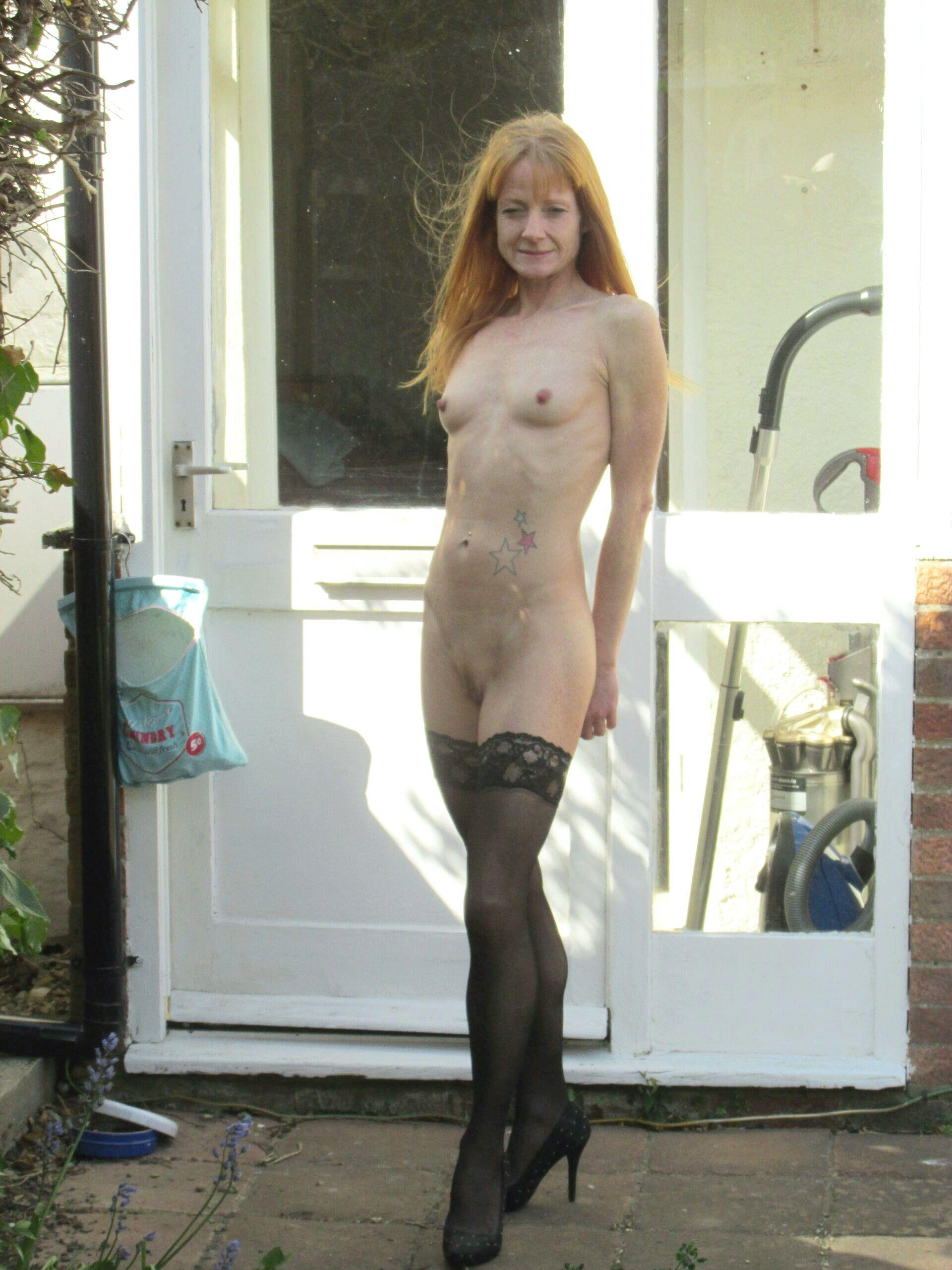 Redheaded mature slut by the door. real nudity public nudity mature