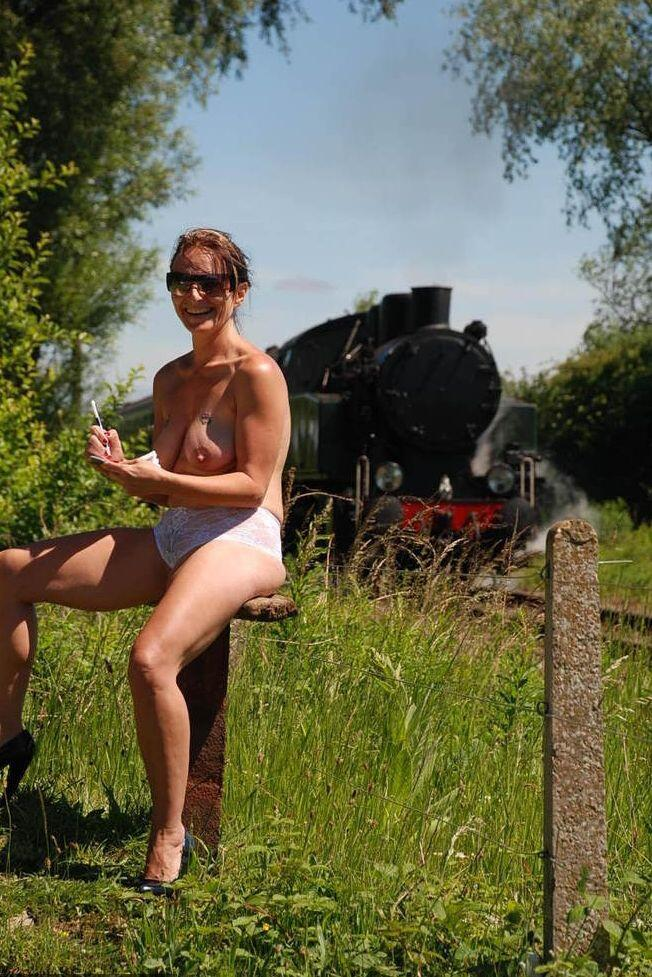 Mature slut likes to go train spotting.