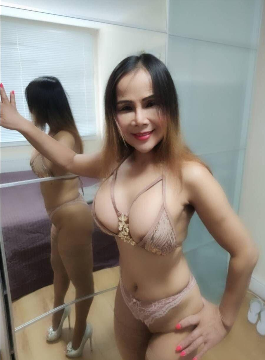 Thai milf slut in the morning with bra and panties.
