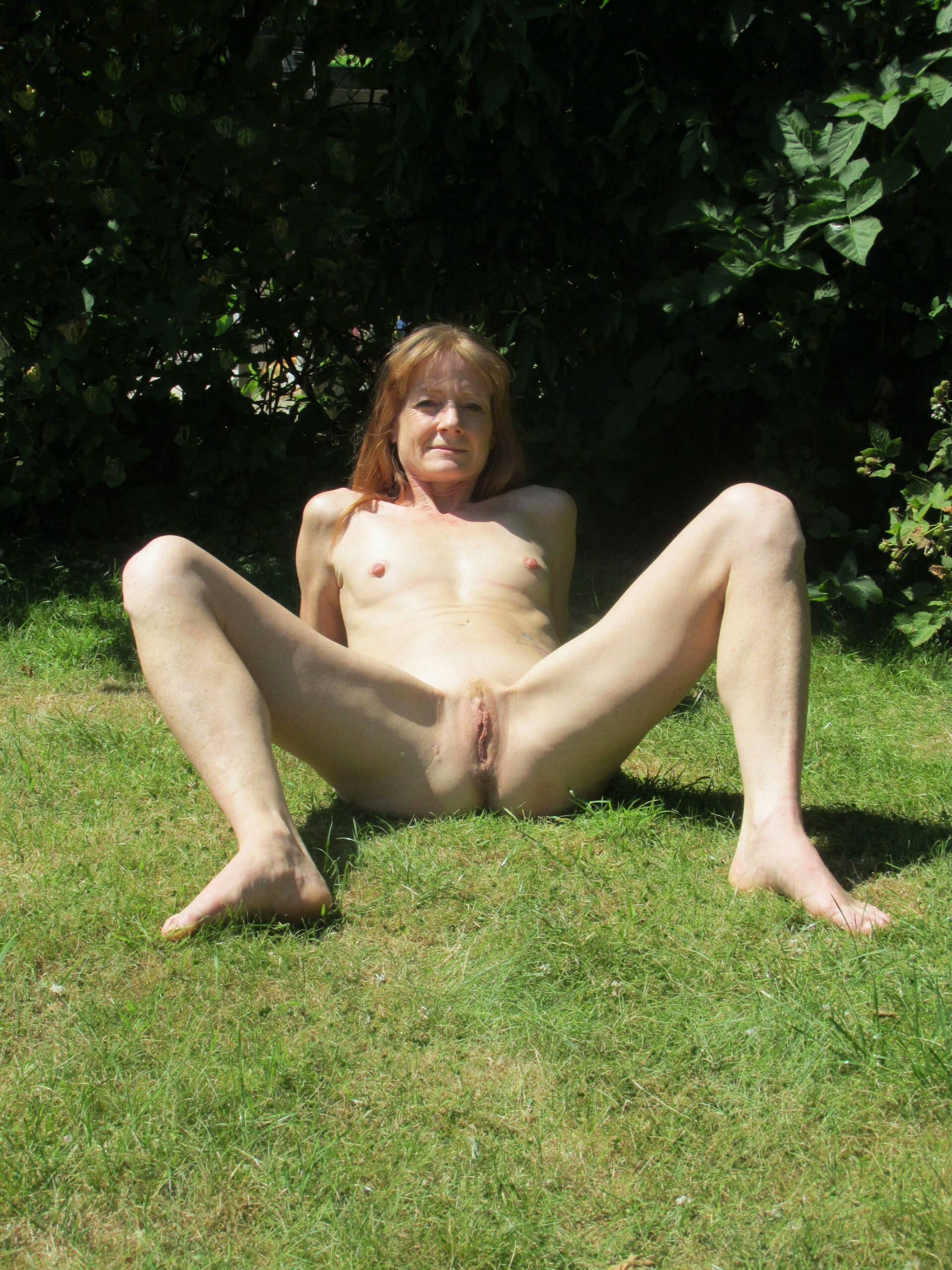 Redheaded fuck slut in her garden real nudity public nudity mature howife
